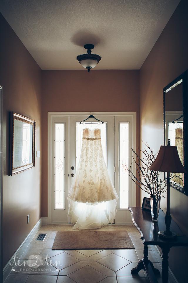 wedding gown in doorway, toronto wedding photographer, should i buy a wedding album, how to photograph a wedding gown