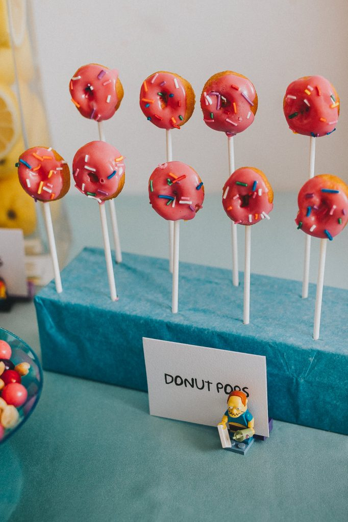 the simpsons baby shower, simpsons inspired food, simpsons, simpsons themed party, simpsons themed wedding, mini donut pops