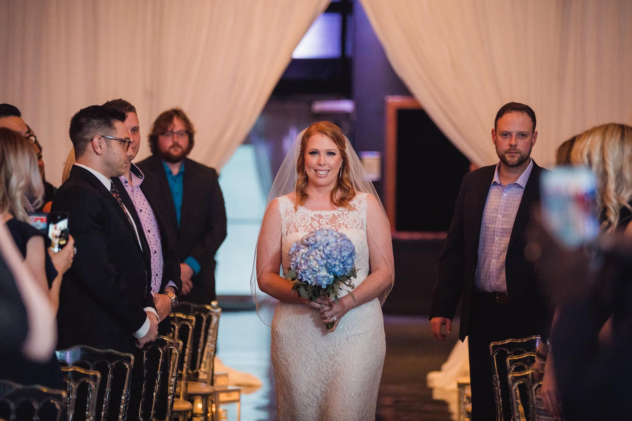 bride walking down the aisle ymg