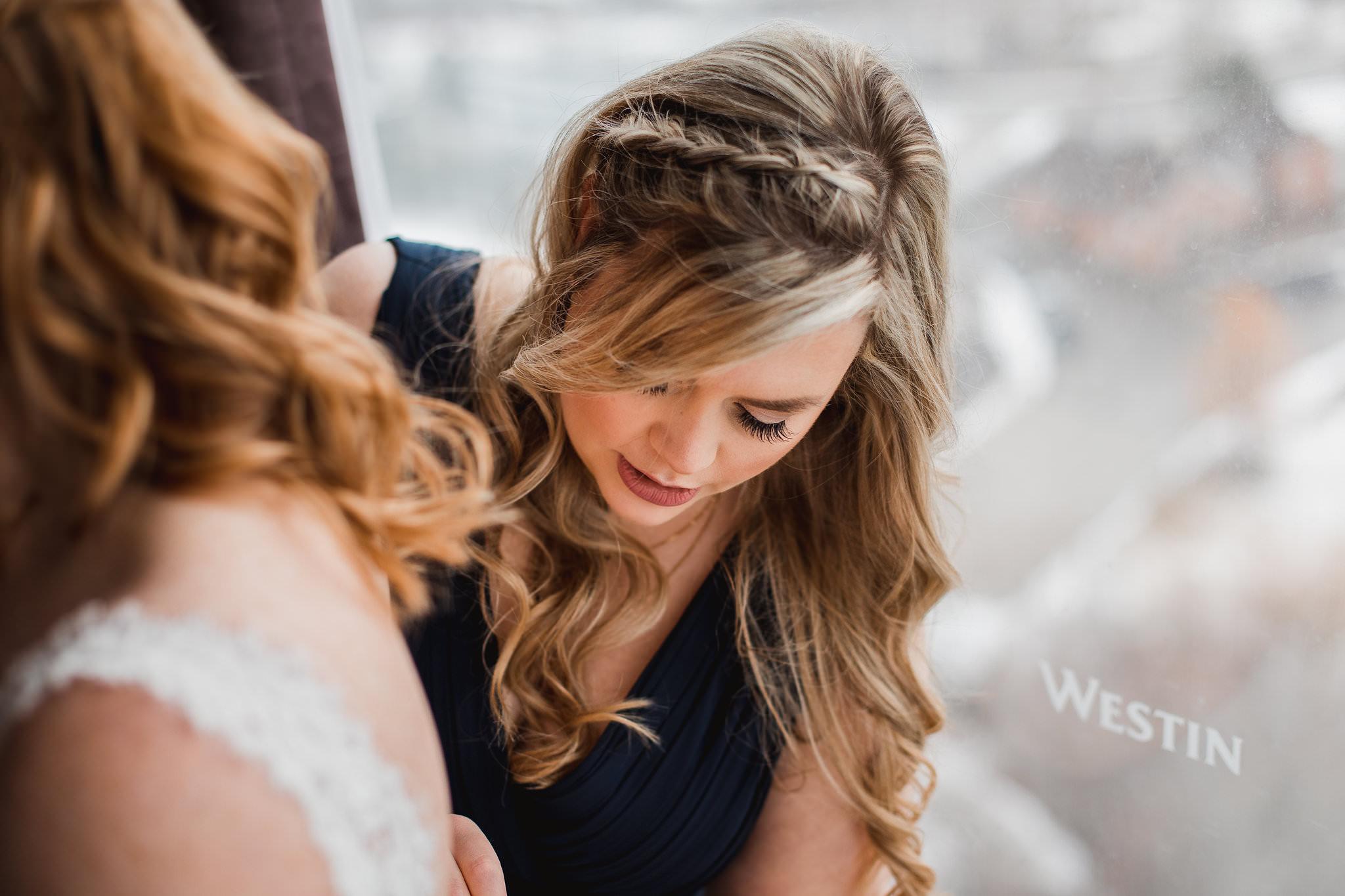 bridesmaid helping bride get ready toronto