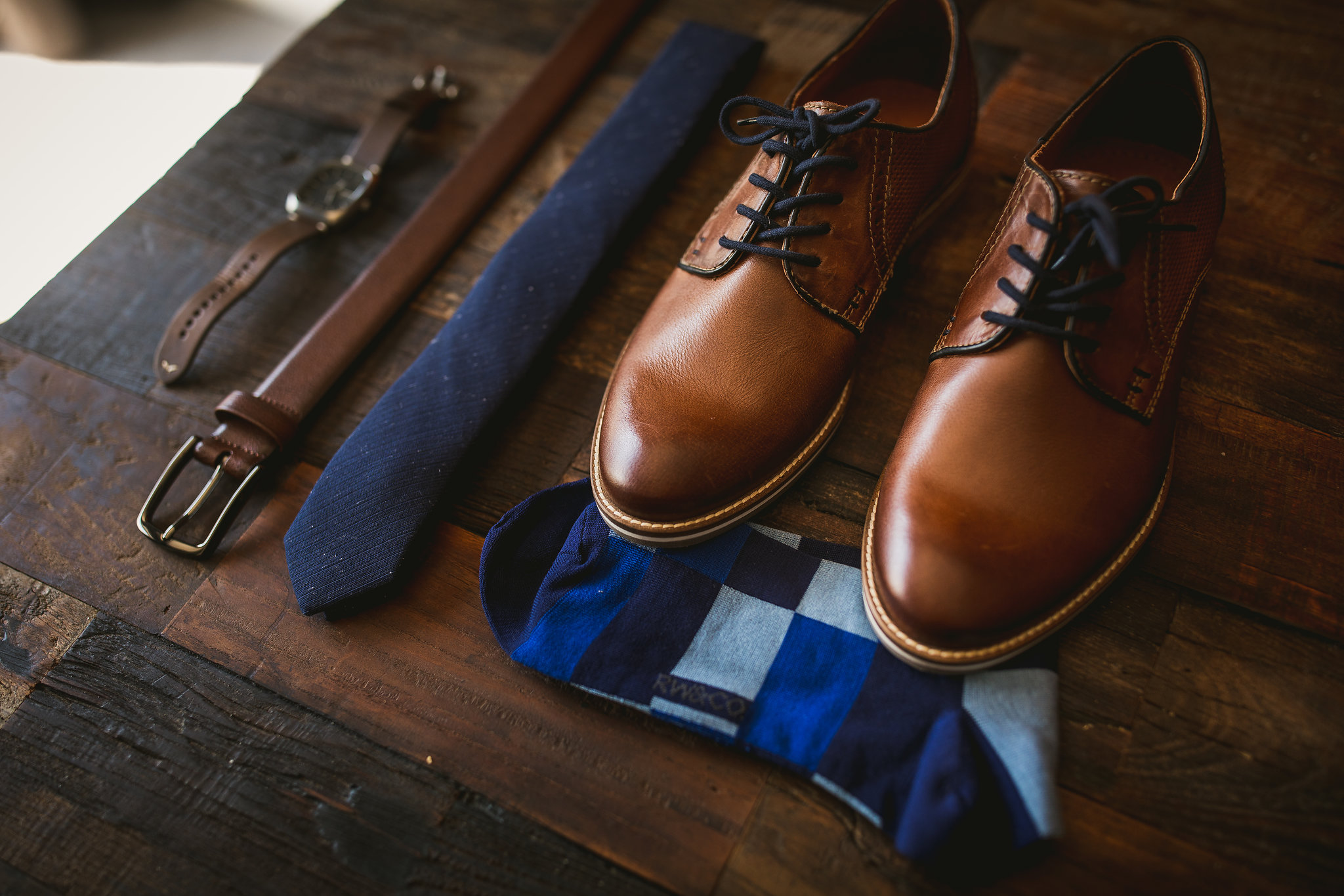 grooms wedding details with blue socks