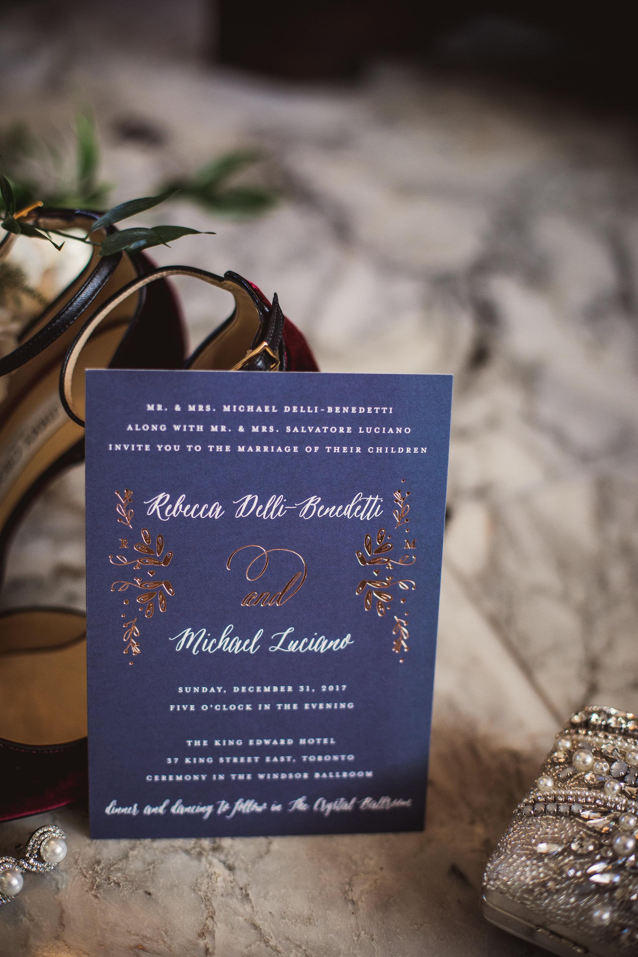 wedding detail shot of invitation