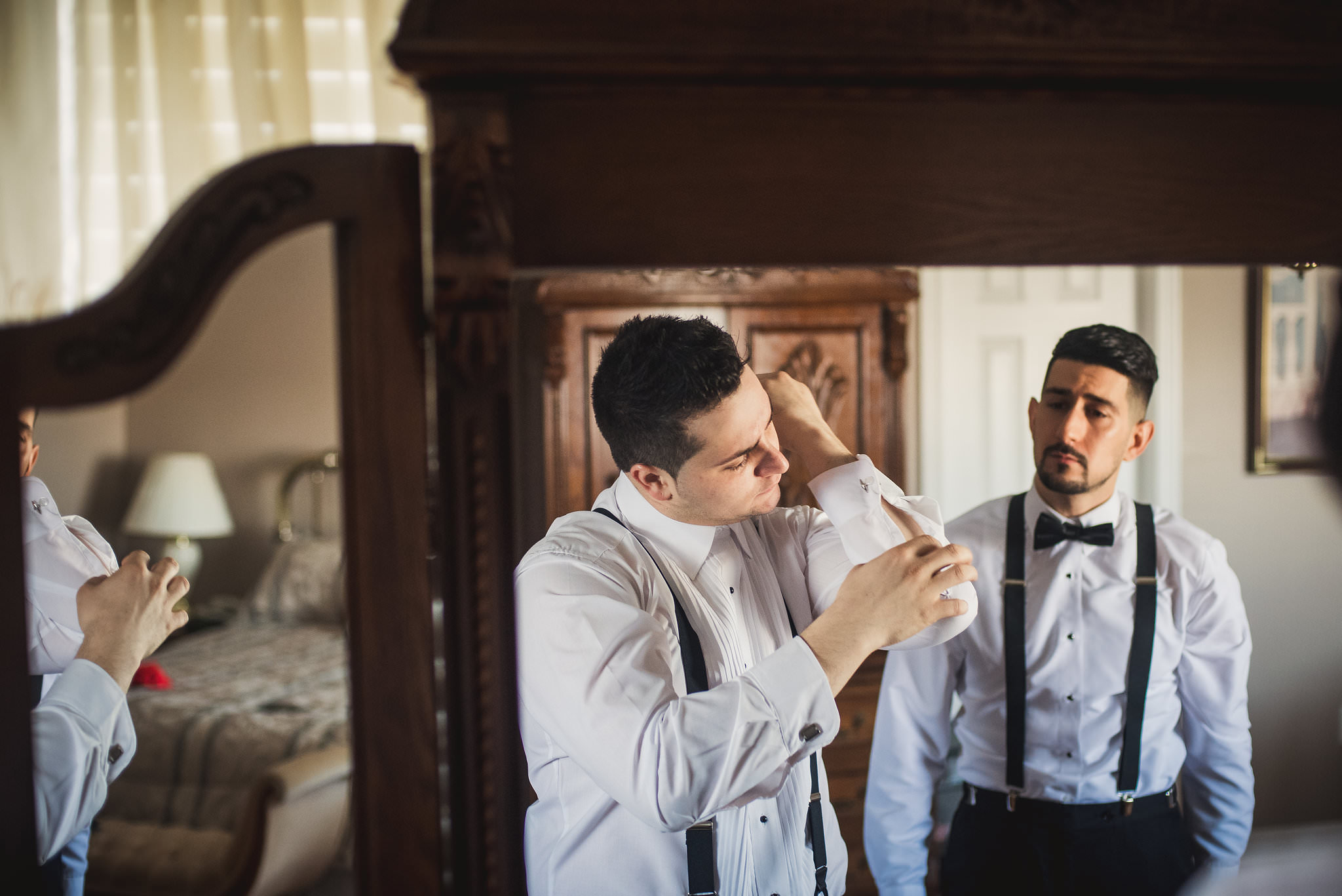 grooms getting ready with help from friends