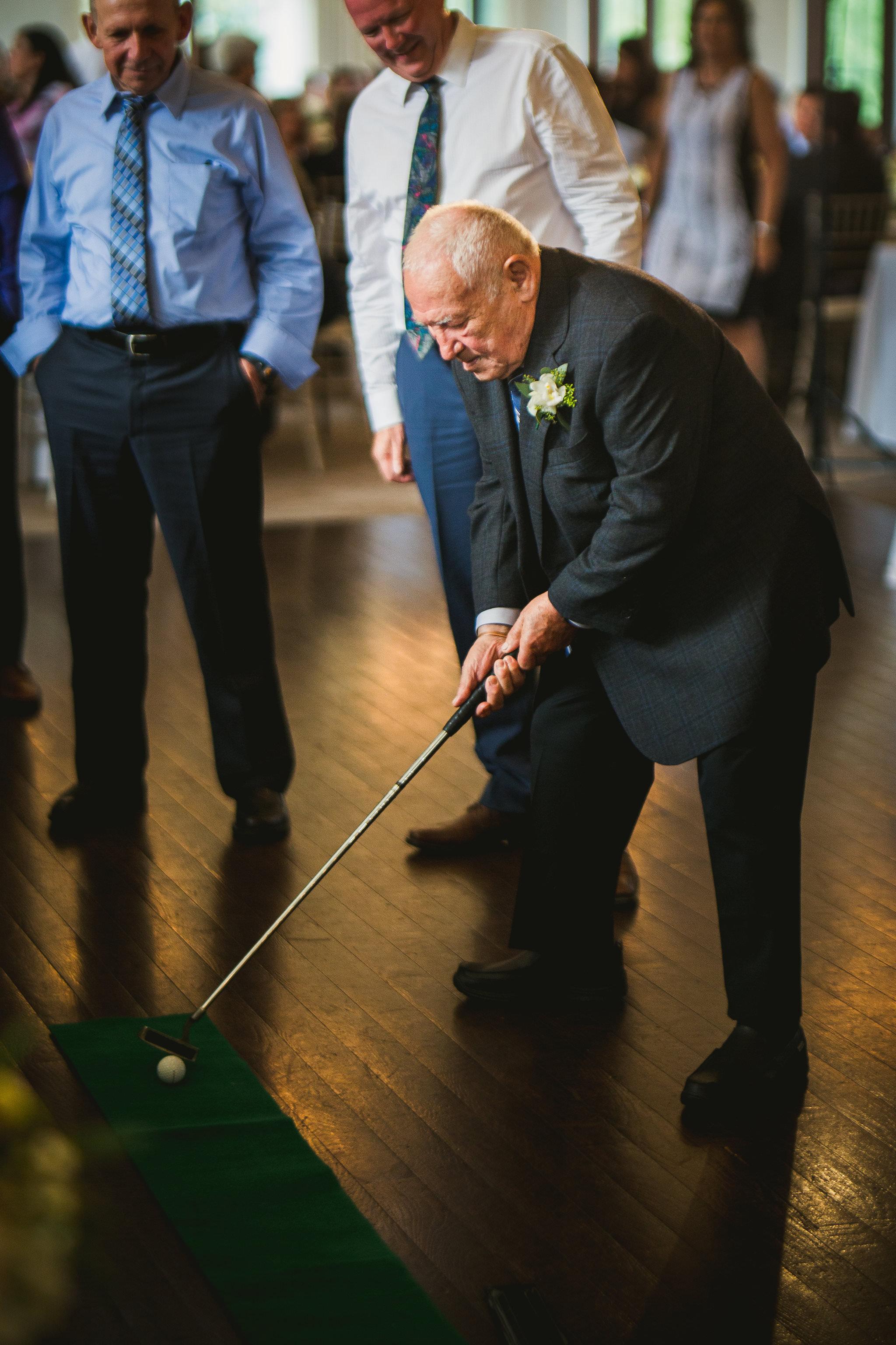 grandpa playing golf at whistle bear wedding