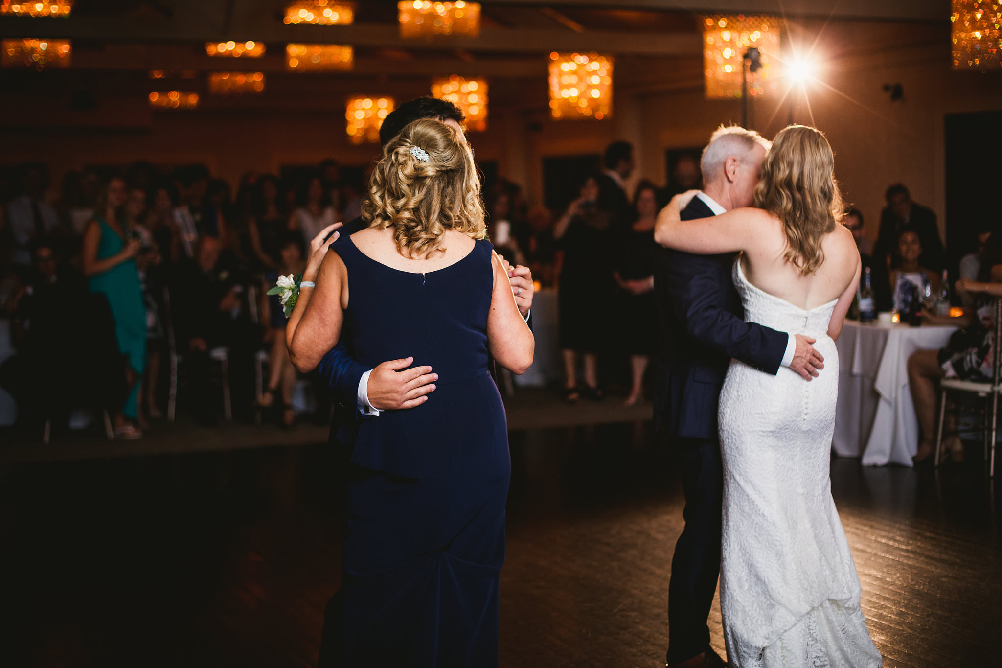 bride and father and groom and mother dance at same time