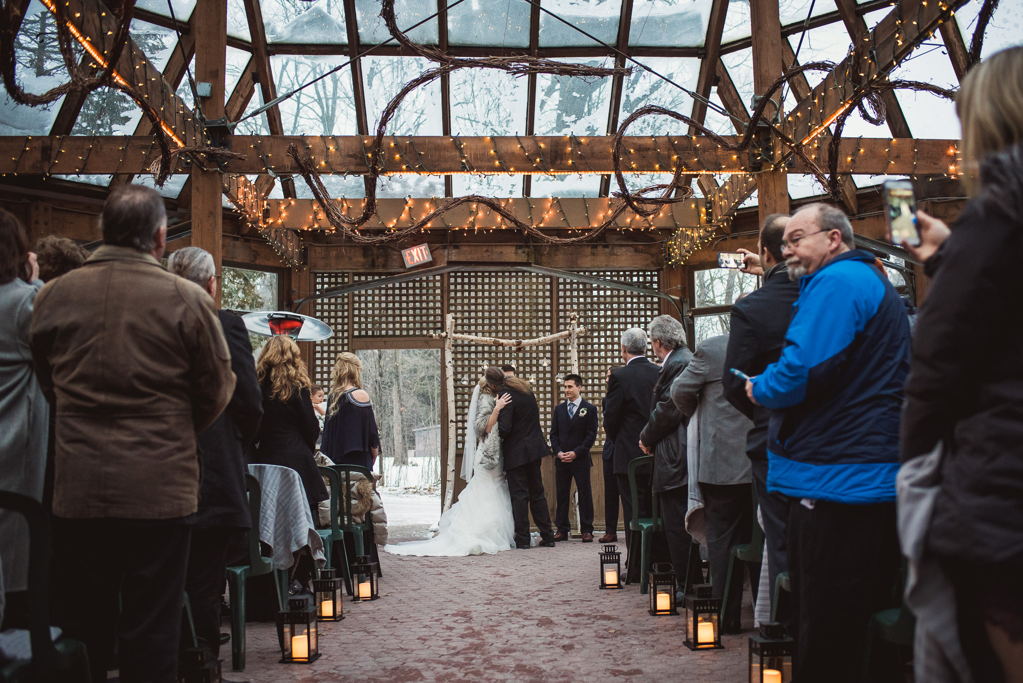 glass house wedding ceremony in the winter