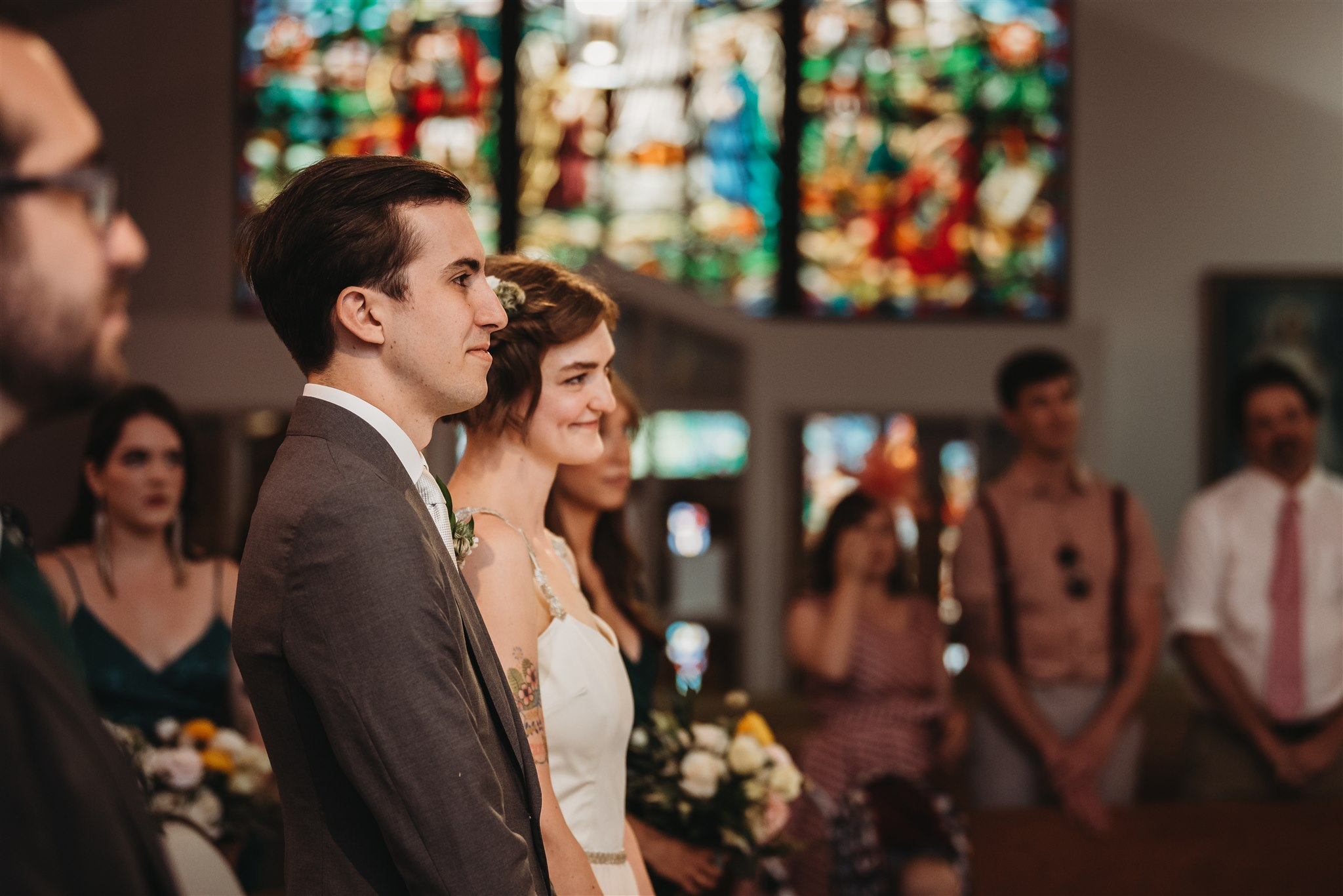 bride and groom standing at the altar in polish catholic church