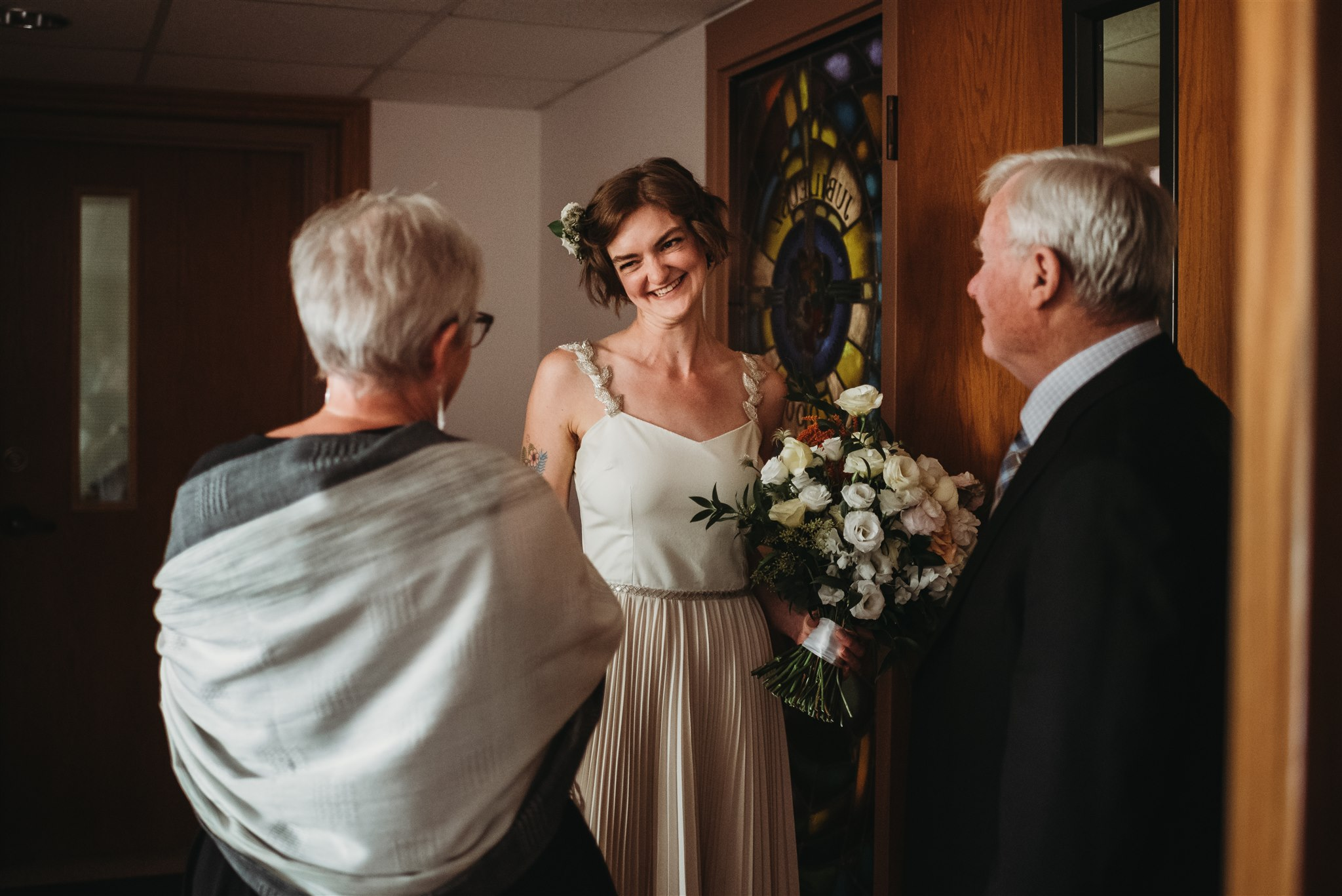 bride smiling happily after exiting the church