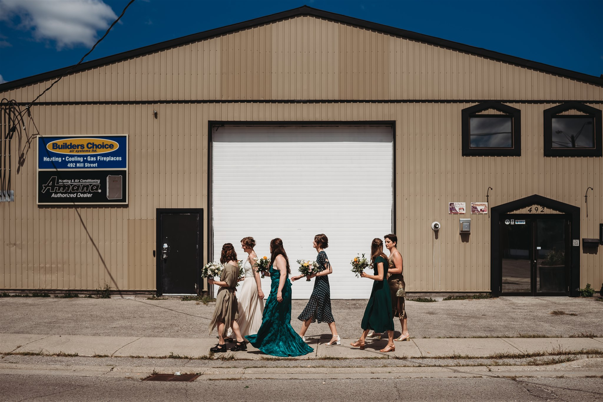 bride and bridesmaids walking to wedding ceremony in london ontario